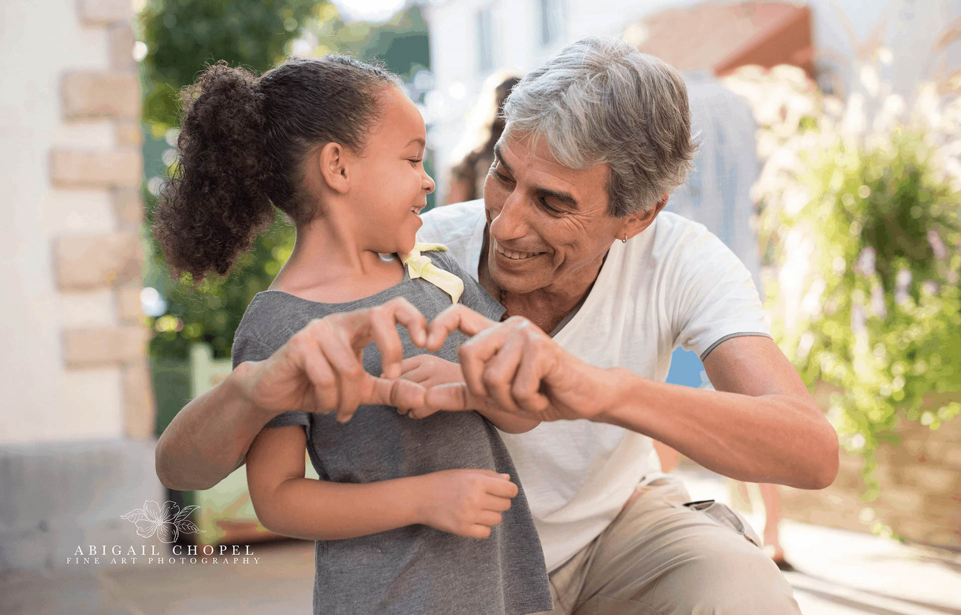little girl and grandpa saying i love you