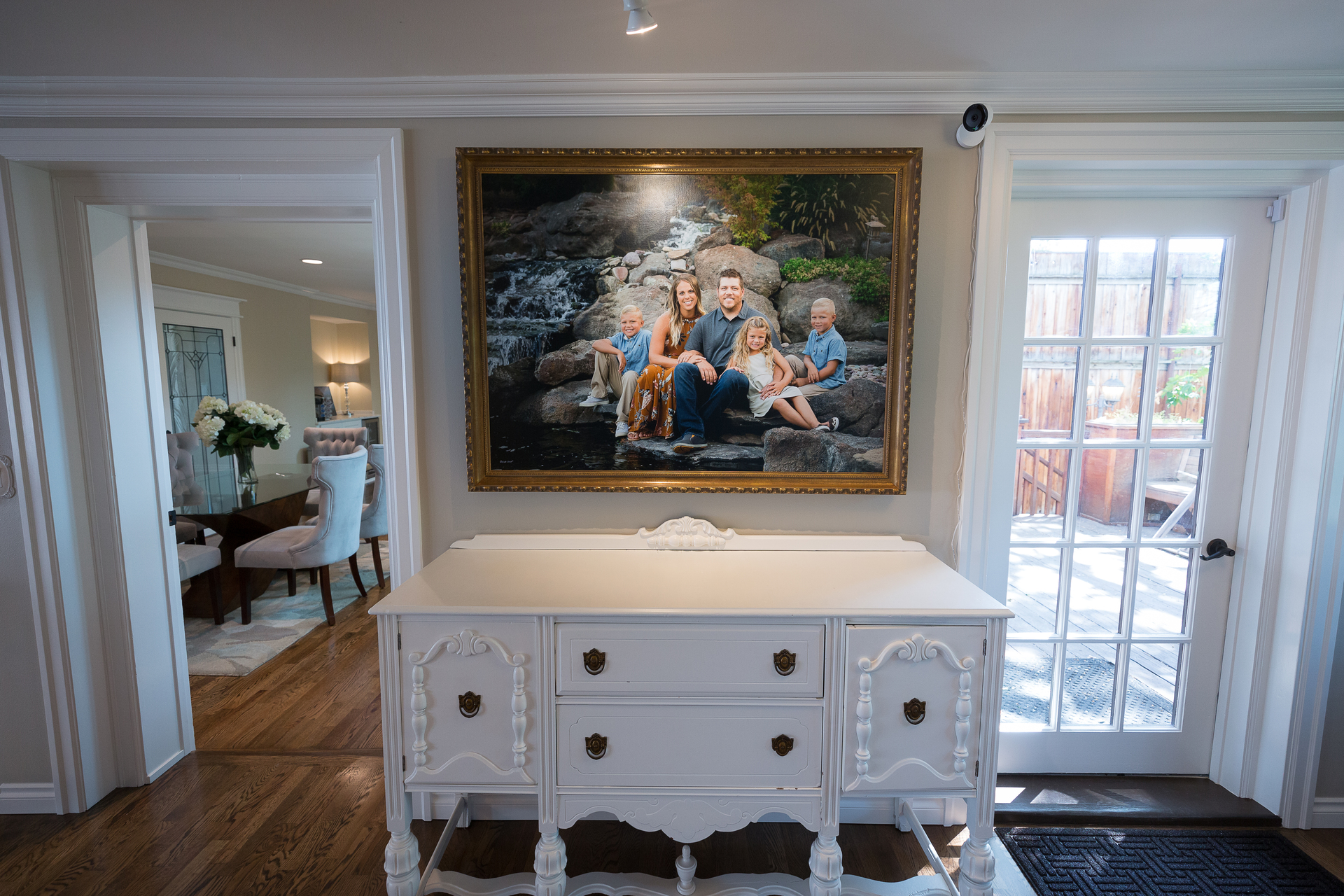 framed picture of smiling family in foyer